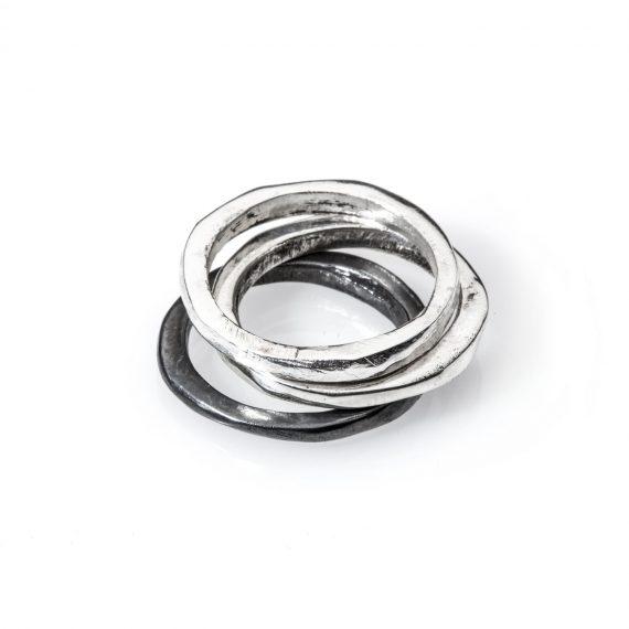 Trittico Ossi di Seppia, un anello in argneto ossidato e due anelli in argento bianco